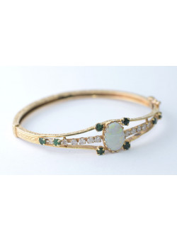 Gorgeous 14K Gold Engraved Bracelet Mounted With Central Large Opal, Diamonds Emeralds and Sapphires